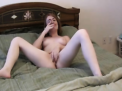 Redhead cutie fingers her cunt to orgasm in front of a web camera