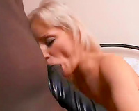 Two Blondes Enjoy Leather Gloves And Cum