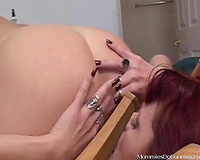 Redhead and brunette hair use a dildo to satisfy every other in lesbo vid