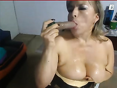 Mature blond fists her cum-hole and sucks a marital-device in livecam solo movie scene