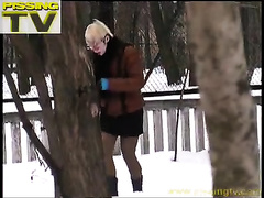 Just a Russian golden-haired dilettante woman pees underneath the tree