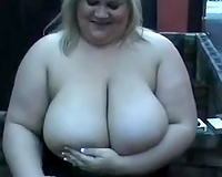 big beautiful woman blond with large love bubbles looks hot whilst smokin'