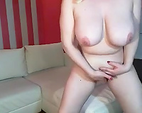 Bosomy blond mamma plays with her jugs and her slit