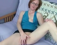 My dilettante nerdy redhead white wife on the daybed masturbating