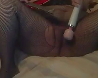 Filthy granny in torn fishnets masturbates with a wand