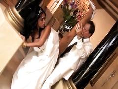 Beautiful bride in wedding suit receives screwed from behind