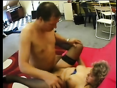 Chubby older blond gives head to a stud and receives her cunt group-fucked