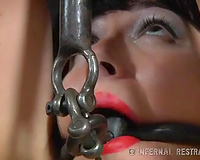 Restrained brunette whore with clamps on her nipples punished in the barn