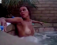 My slim GF flashes her natural milk cans while bathing in a pool