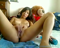 Classy Asian cam model fucks her moist fanny with her rabbit sex-toy