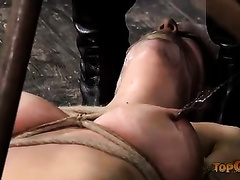Seducing blond slutty wife fastened on the floor acquires her vagina toyed